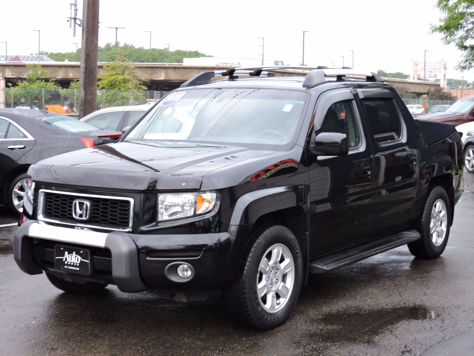 used 2006 honda ridgeline rtl awd moonroof at auto house. Black Bedroom Furniture Sets. Home Design Ideas